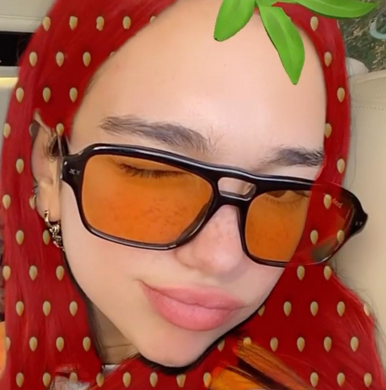 Dua Lipa In Lexxola's Damien Sunglasses in orange.