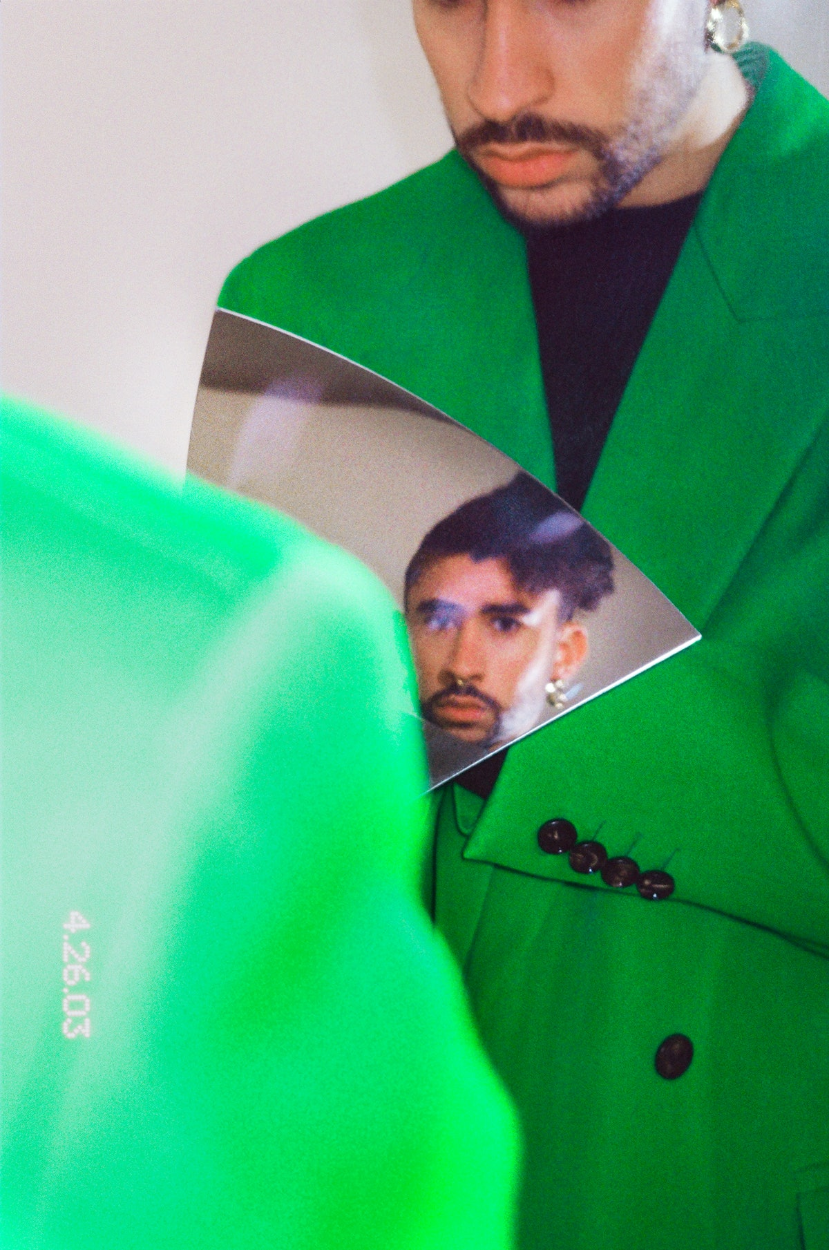Bad Bunny in green Bottega Veneta suit