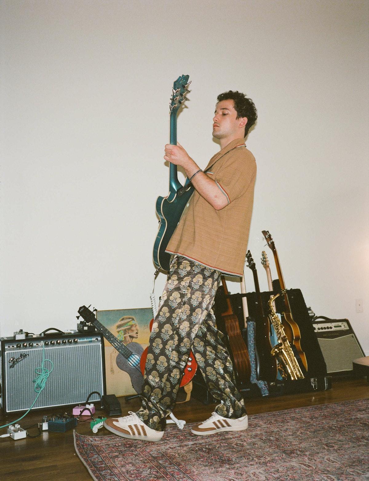 Eli Brown plays guitar