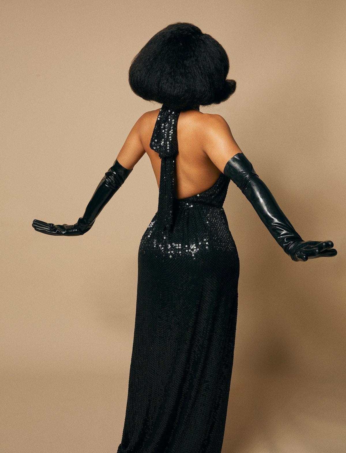 Saweetie in black Celine by Hedi Slimane dress