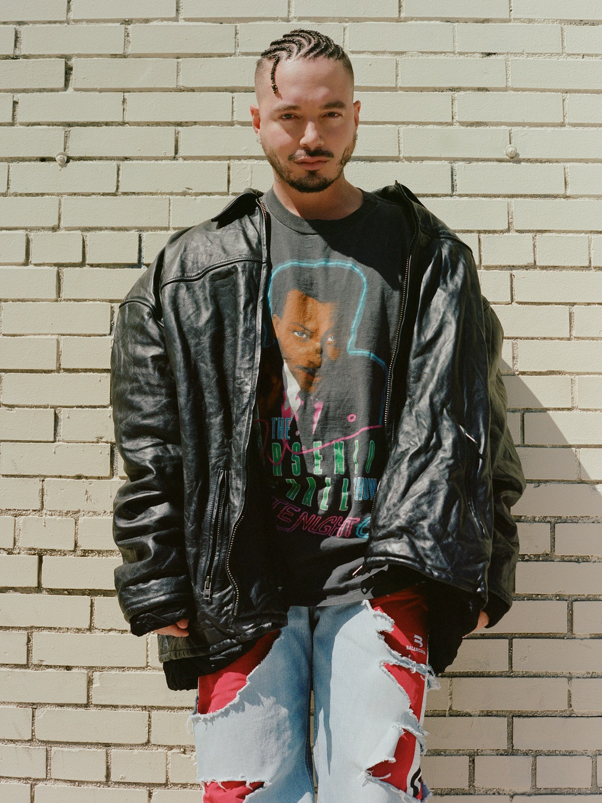 J Balvin in a Balenciaga jacket, jeans, and shoes; his own T-shirt.