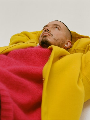 J Balvin in a Raf Simons jacket and sweater.