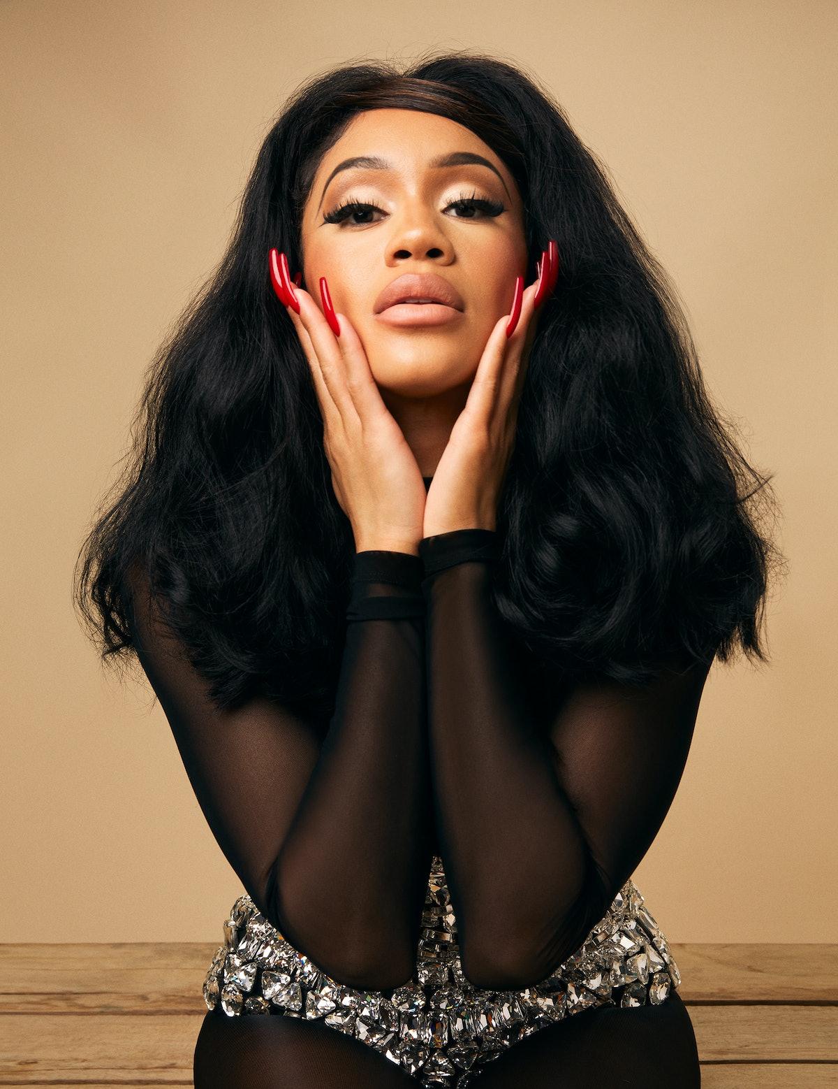 Saweetie wears a Dolce & Gabbana crystal bodysuit. Photographed by John Edmonds.