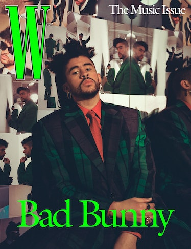 Bad Bunny wears a Louis Vuitton Men's jacket, shirt, skirt, and tie; rings: (from top) Vitaly, Jewel...