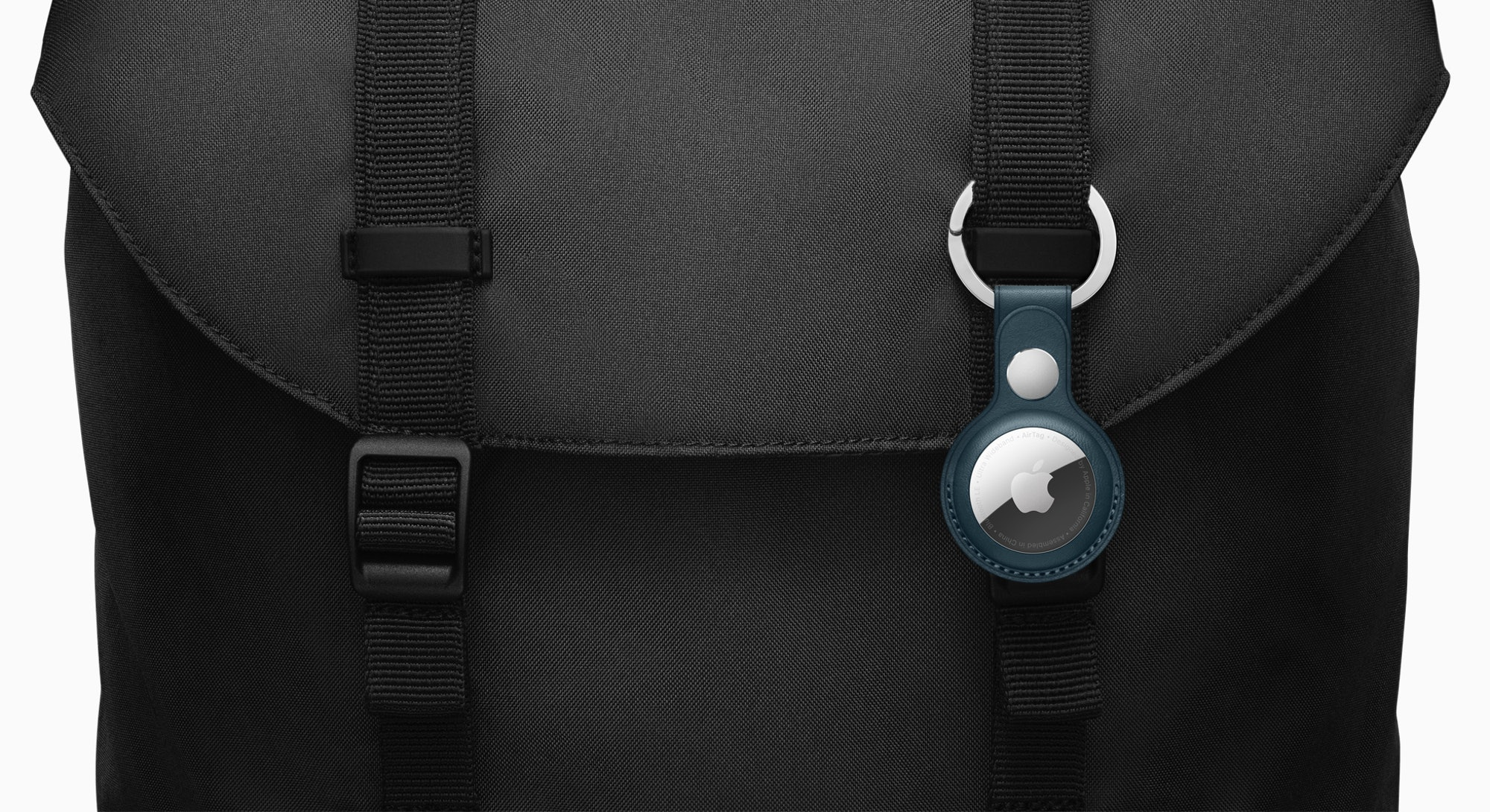 Apple AirTags clipped onto bag.