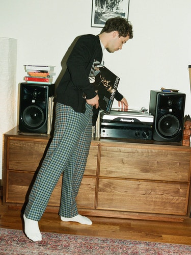 Eli Brown in black sweater
