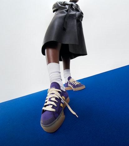 Model wearing Adidas x Wales Bonner sneakers.