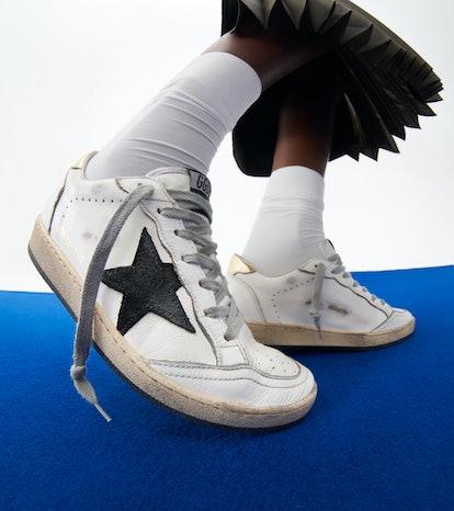 Model wearing Golden Goose sneakers for NET-A-PORTER.
