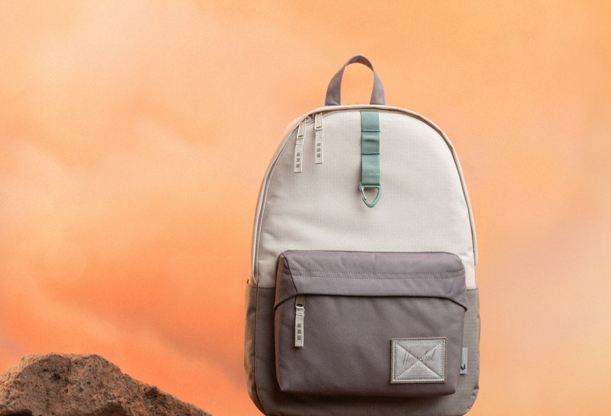 A Baby Yoda-inspired backpack from the Herschel x 'Star Wars' 'The Mandalorian' collection sits on s...