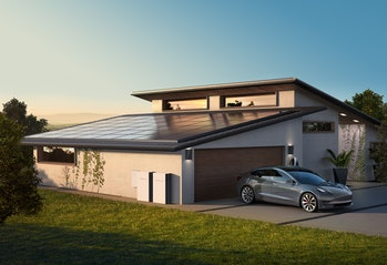 Tesla solar panels with Powerwall batteries attached. The setup is part of the firm's overall vision...