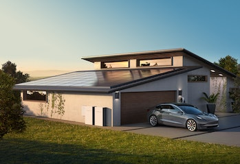 Tesla solar panels with Powerwall batteries attached. The setup is part of the firm's overall vision for solar panels.