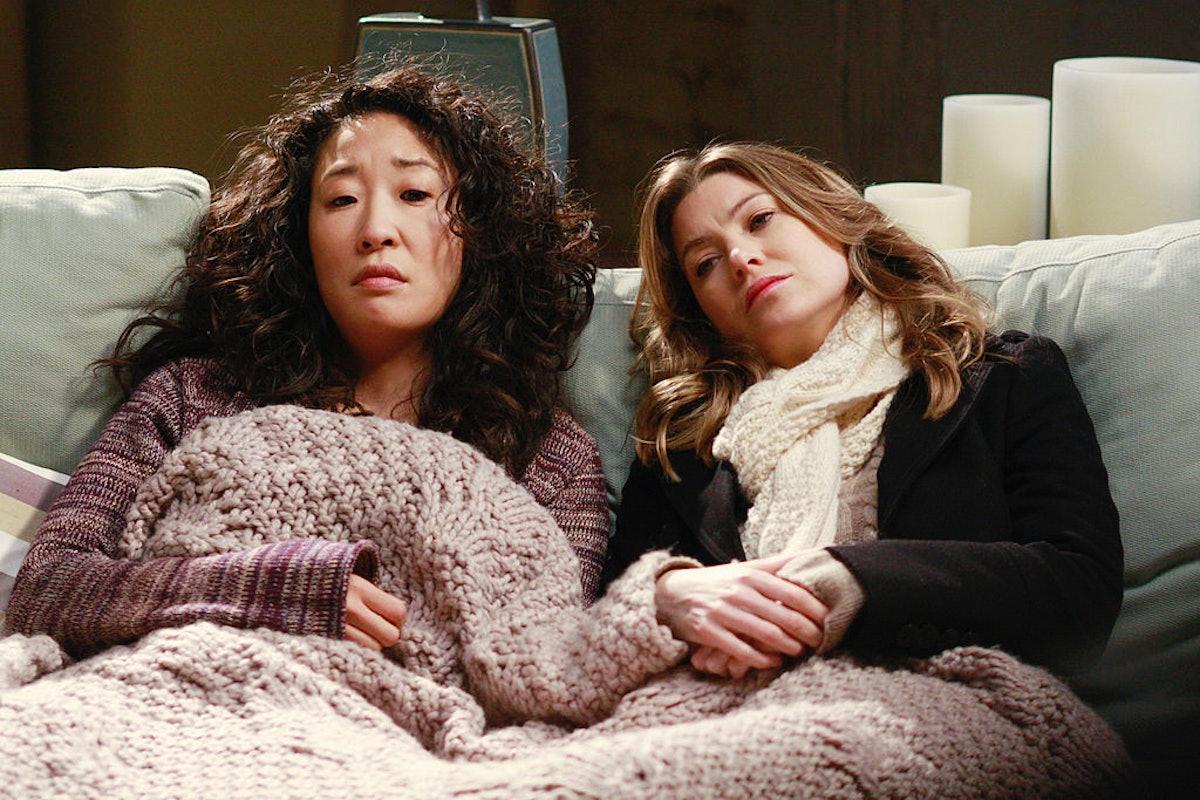 Sandra Oh as Cristina Yang and Meredith Grey as Meredith Grey in Grey's Anatomy.