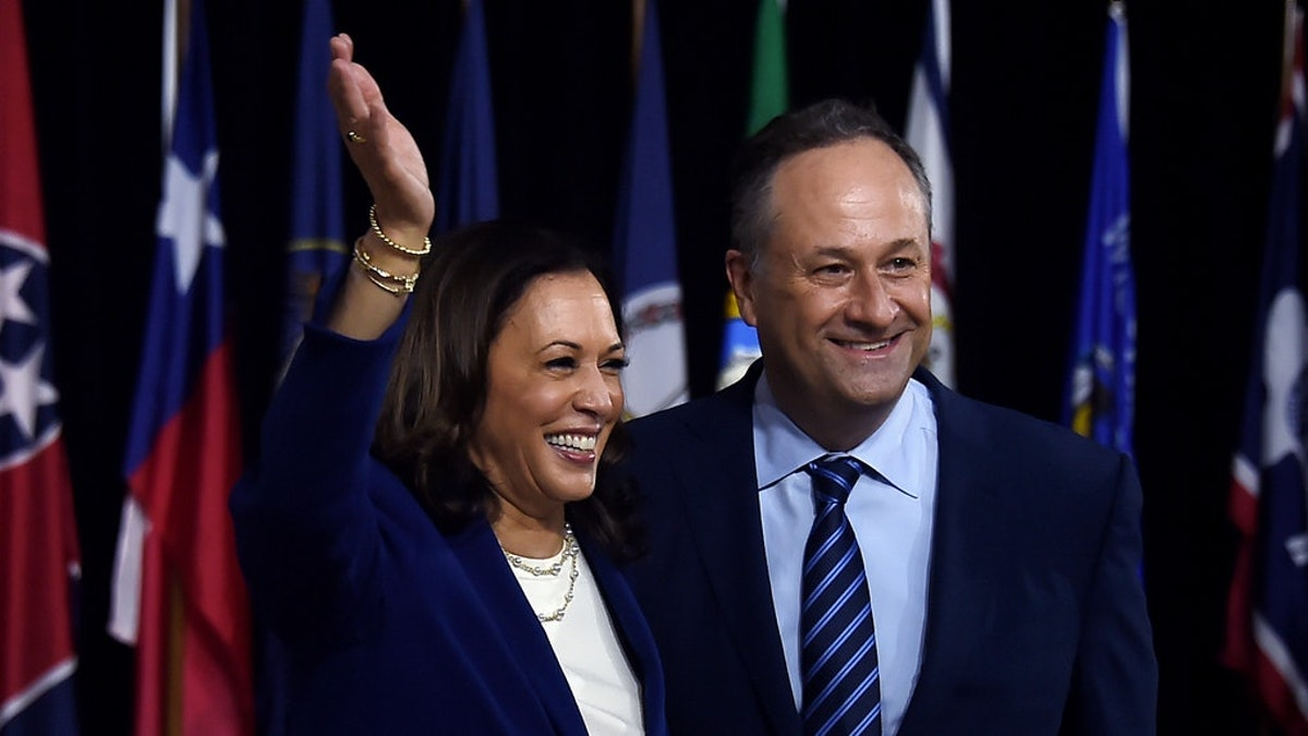 The tweets and memes of Doug Emhoff waving to Kamala Harris are so hype for his support.