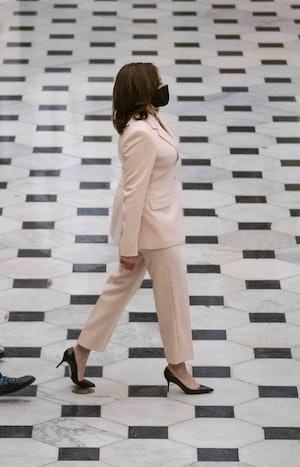WASHINGTON, DC - APRIL 28: U.S. Vice President Kamala Harris followed by Senate Majority Leader Chuc...