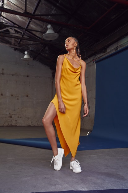 Runway/lookbook image of Monse's Criss Cross Slip Dress from the brand's Spring/Summer 2021 collection. Model Indira Scott.