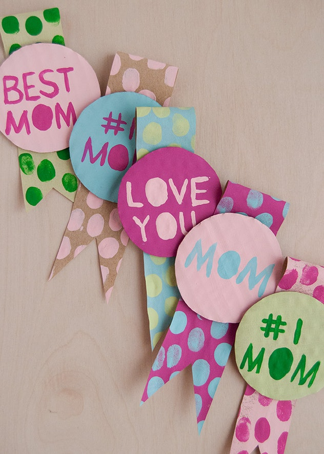 "row of homemade ""best mom"" ribbons (kid craft)"