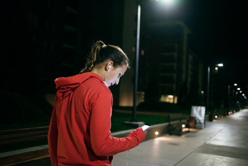 Woman going on a run at nighttime