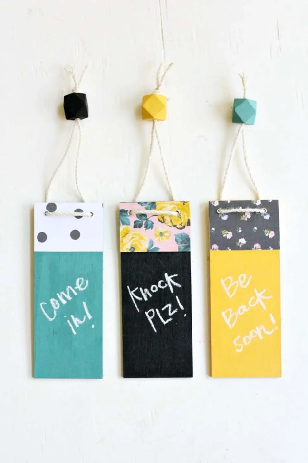 "Three DIY door hangers with different patterns that say ""come in"" ""knock plz"" and ""be back soon"""