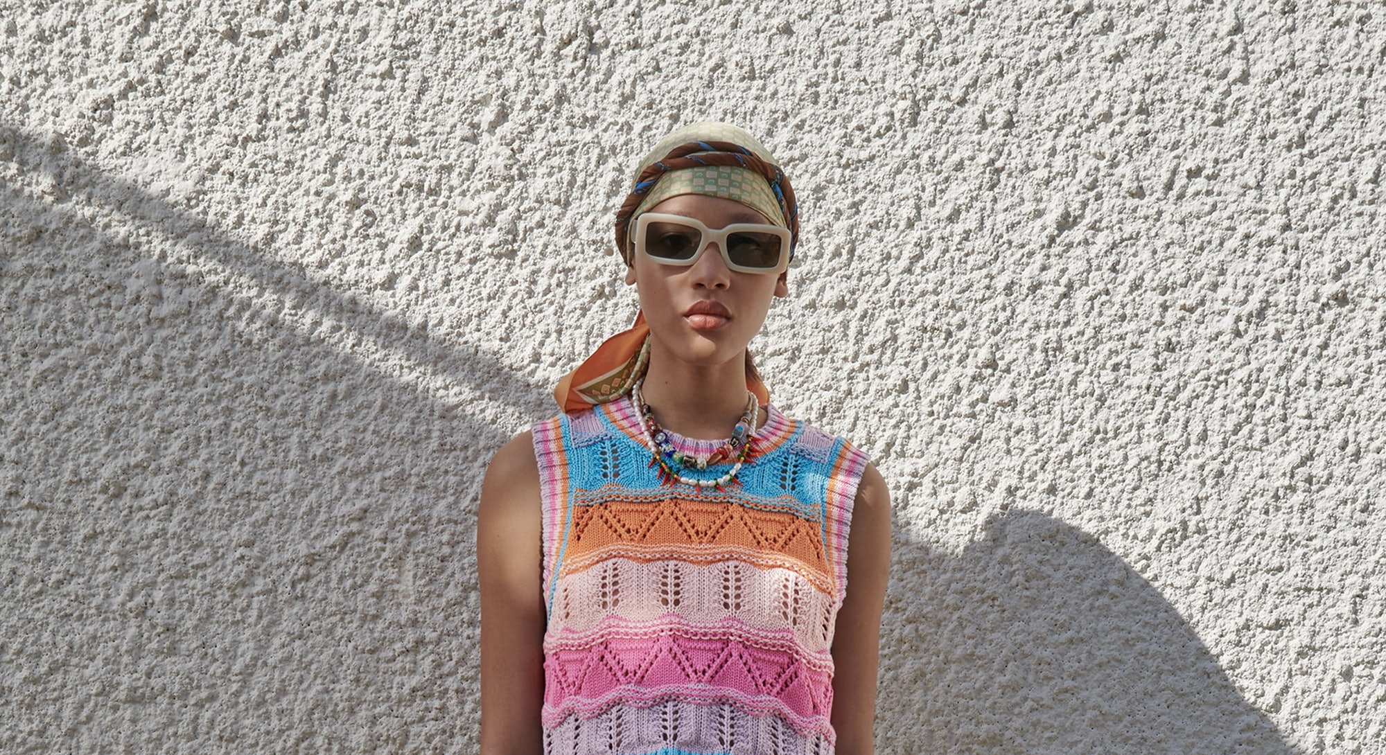 Model wearing Zara crochet knit top.