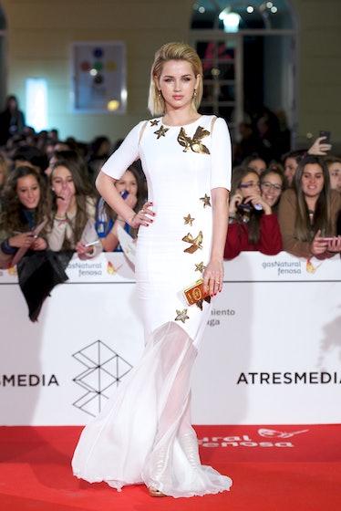 Ana De Armas white and gold dress.