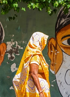 A person walking in New Delhi on April 2, 2021