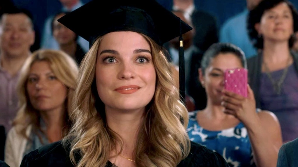 Alexis Rose sits at her graduation ceremony in an episode of 'Schitt's Creek.'