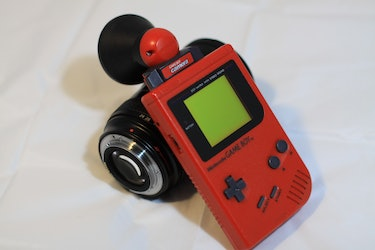 A 3D-printed Canon lens adapter for the Game Boy Camera by Andreas Gack aka Herr Zatacke.