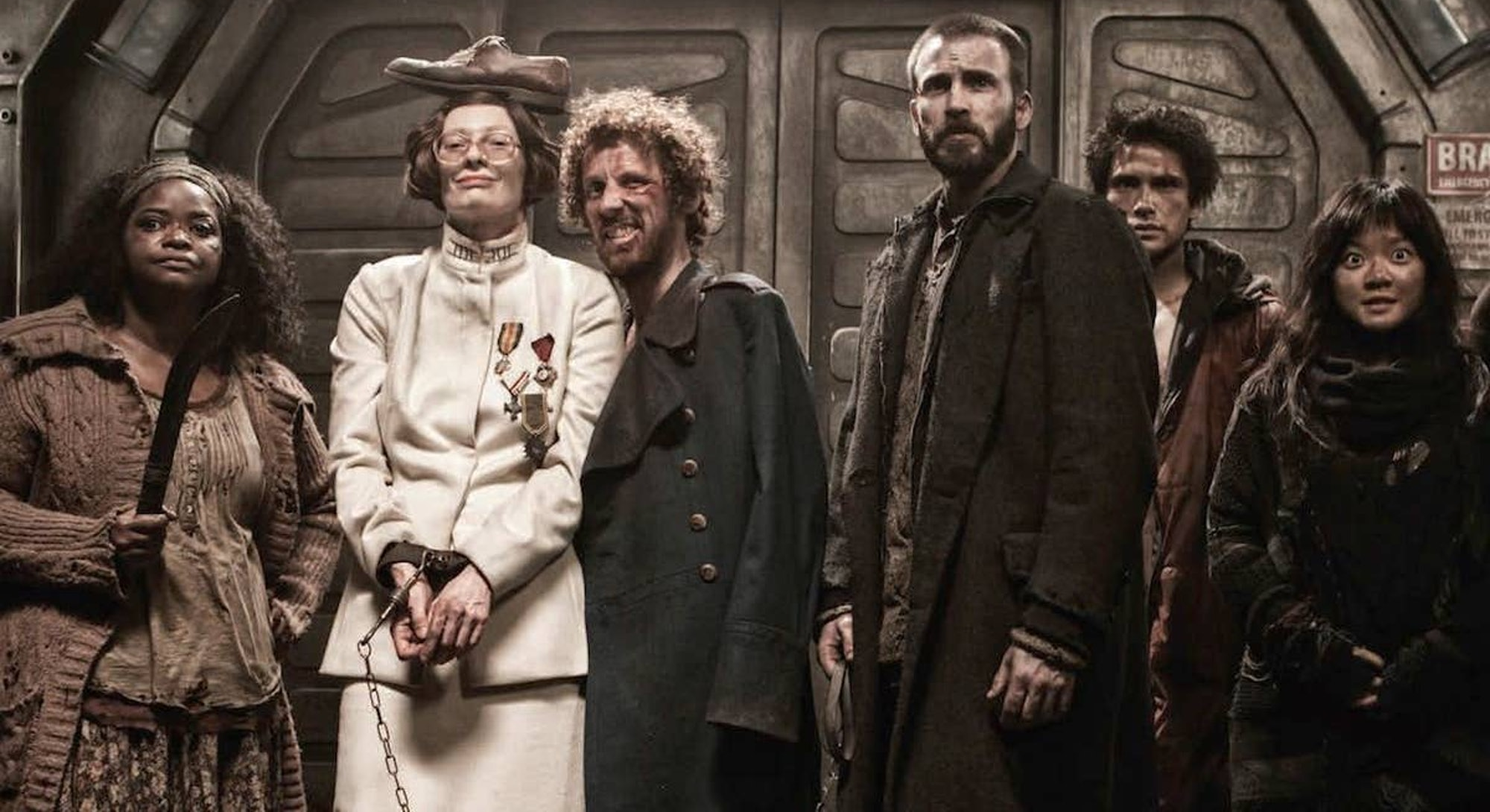 cast of snowpiercer lined up on train