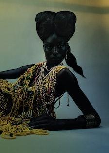 Ruea wears a Lou de Bètoly beaded dress; Jacquemus skirt; Van Cleef & Arpels earrings; Chanel neckla...