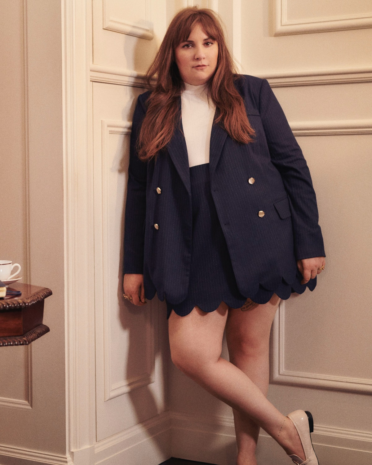 Lena Dunham wears a matching jacket and skirt set from her clothing line collaboration with plus-siz...
