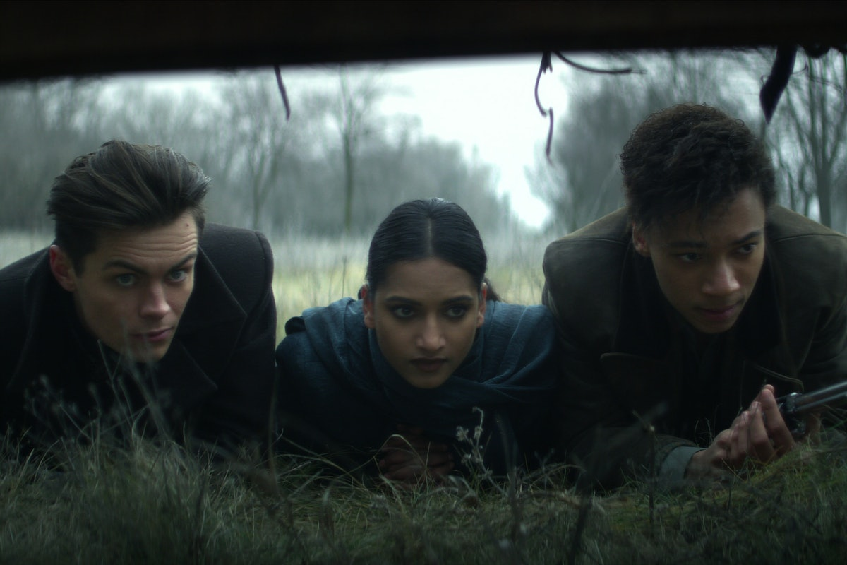 Freddy Carter as Kaz Brekker, Amita Suman as Inej Ghafa, and Kit Young as Jesper Fahey in Six of Cro...