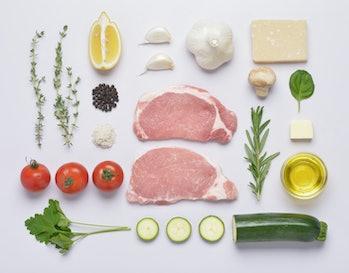 keto foods like meat, garlic, cheese, oil, herbs