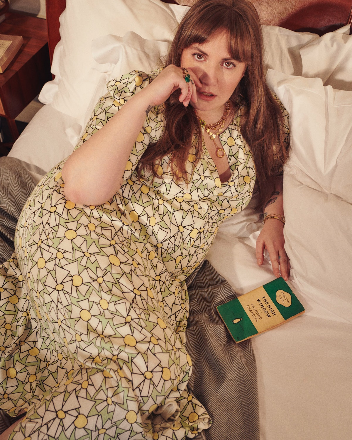 Lena Dunham wears a dress from her clothing line collaboration with plus-size designer brand and onl...