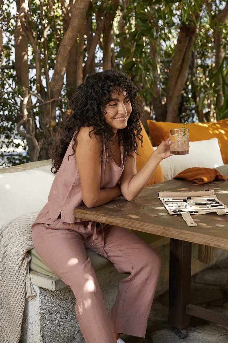 Model wears items from Parachute's linen loungewear collection.