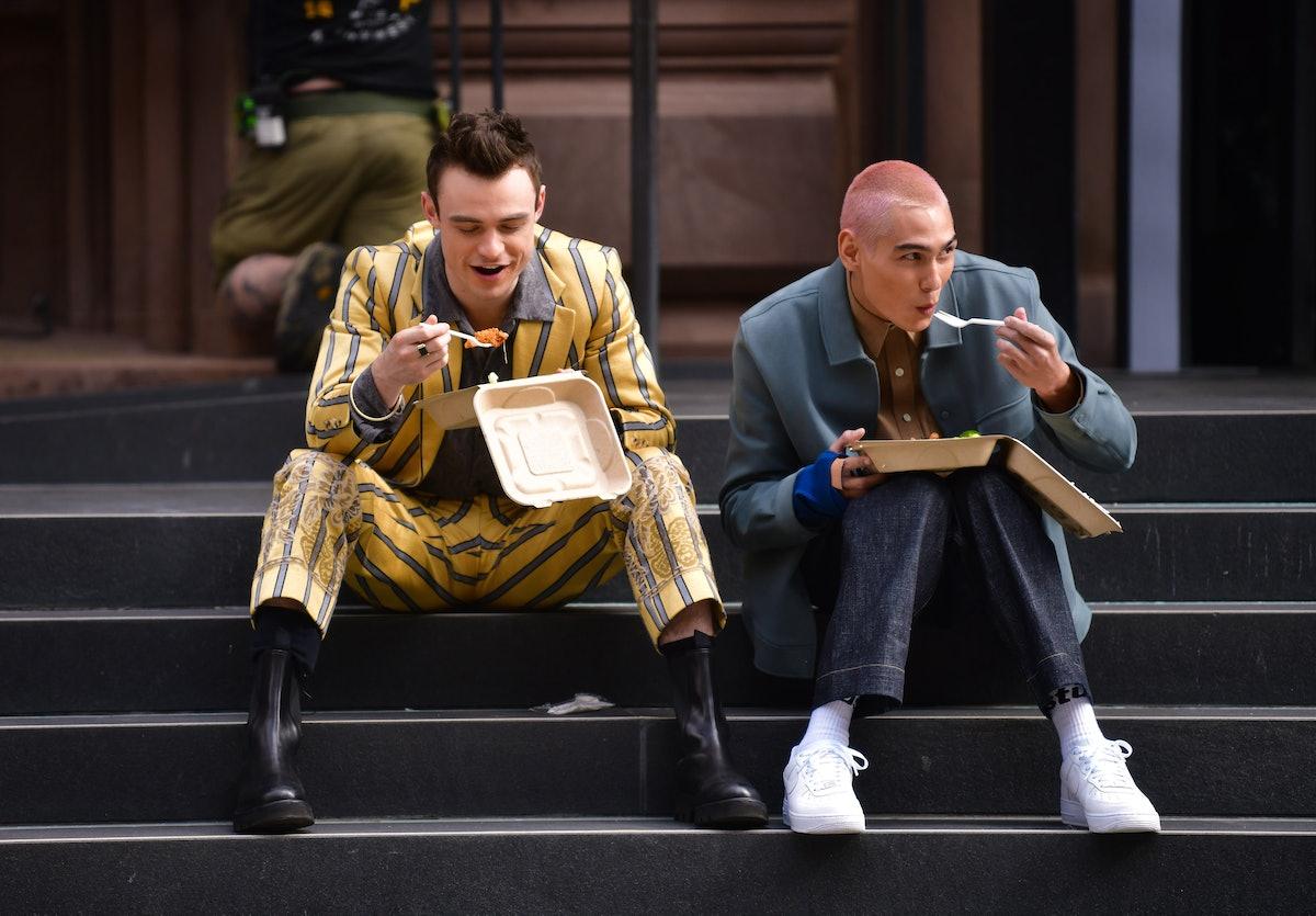 Thomas Doherty and Evan Mock eating salad