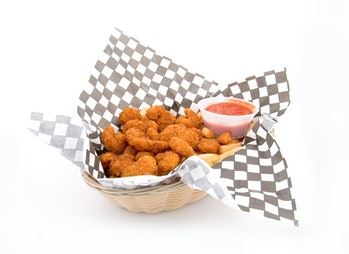 Basket of fried food with ketchup