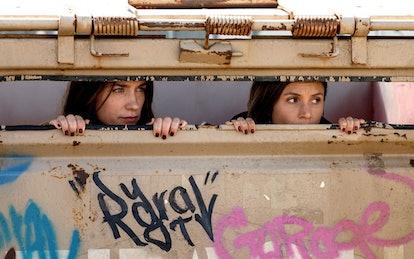 Melanie Scrofano as Wynonna Earp, Dominique Provost-Chalkley as Waverly Earp