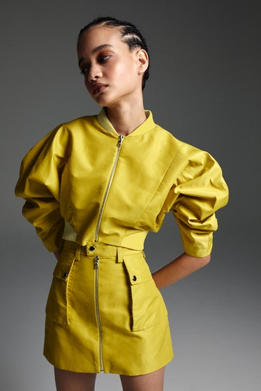 model in yellow jacket and skirt