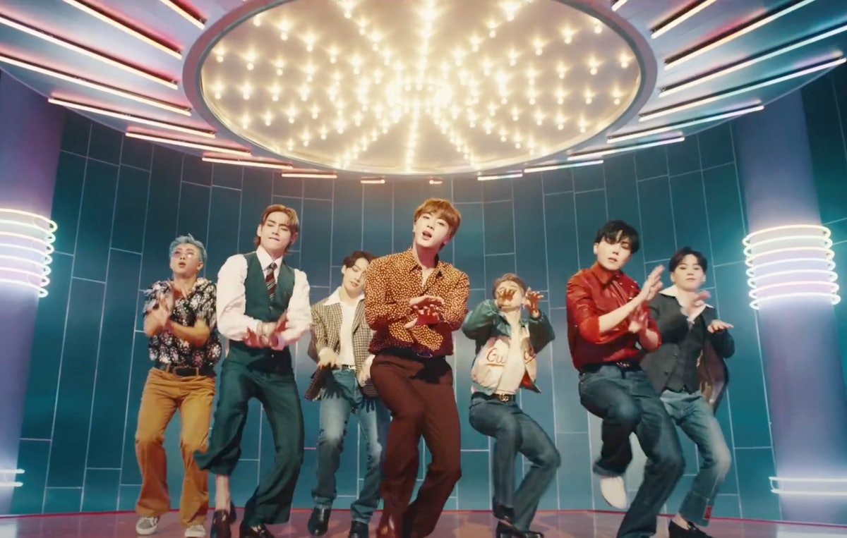 """The members of BTS dance in the music video for """"Dynamite."""""""