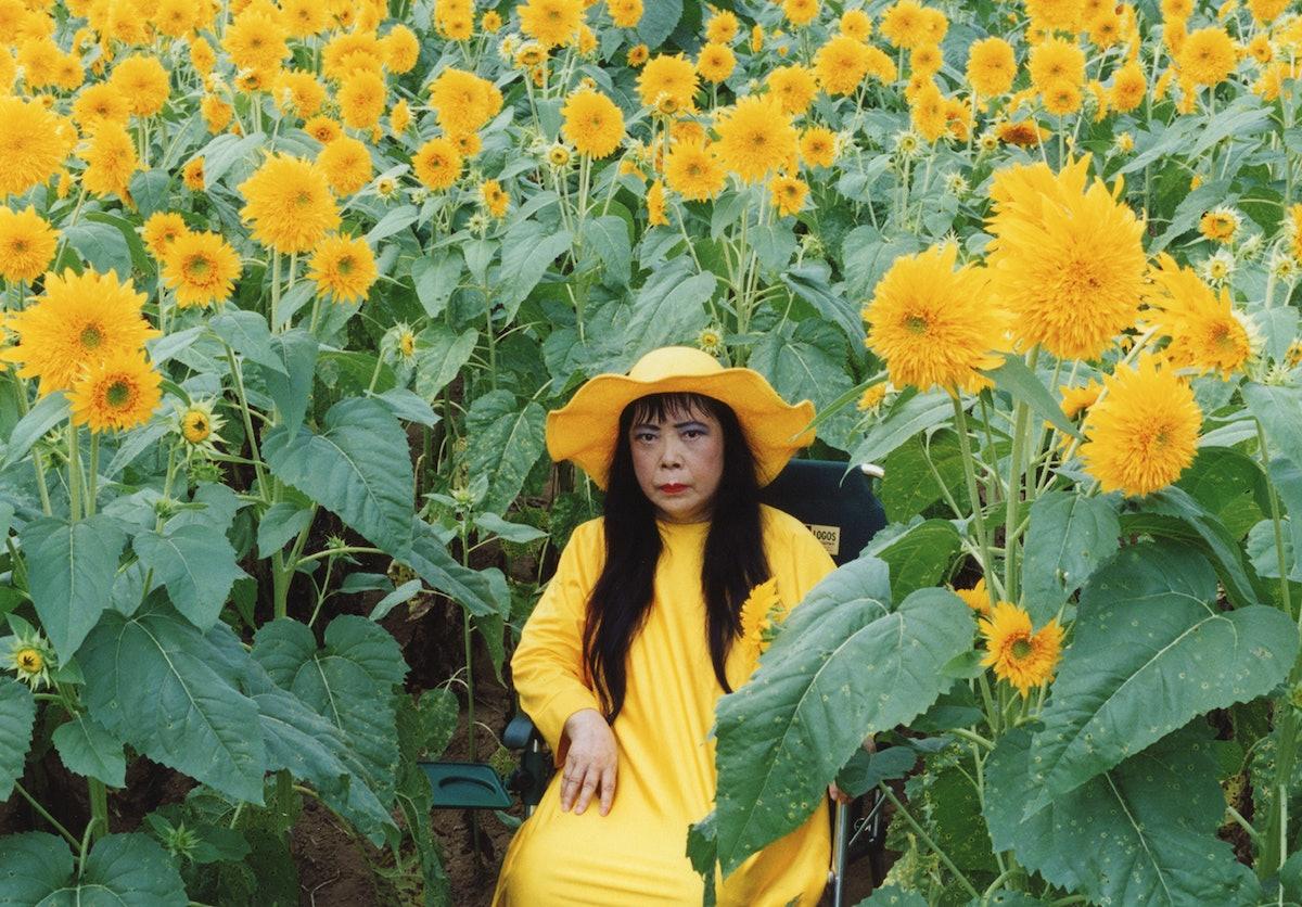 Yayoi Kusama in yellow among yellow flowers