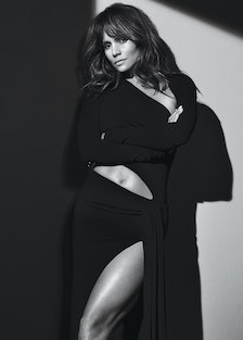 halle berry leaning against a wall