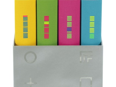 A box of Philip K. Dick books with yellow, green, pink, and blue covers.