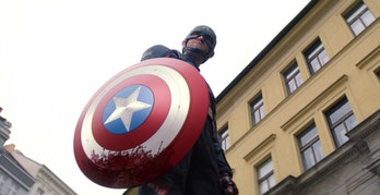 Wyatt Russell as John Walker holding the bloody Captain America shield in The Falcon and the Winter Soldier Episode 4