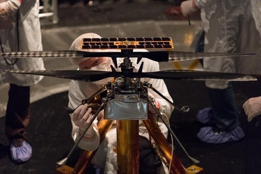 engineers work on mars helicopter