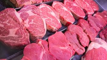 Read meat on grocery store shelf