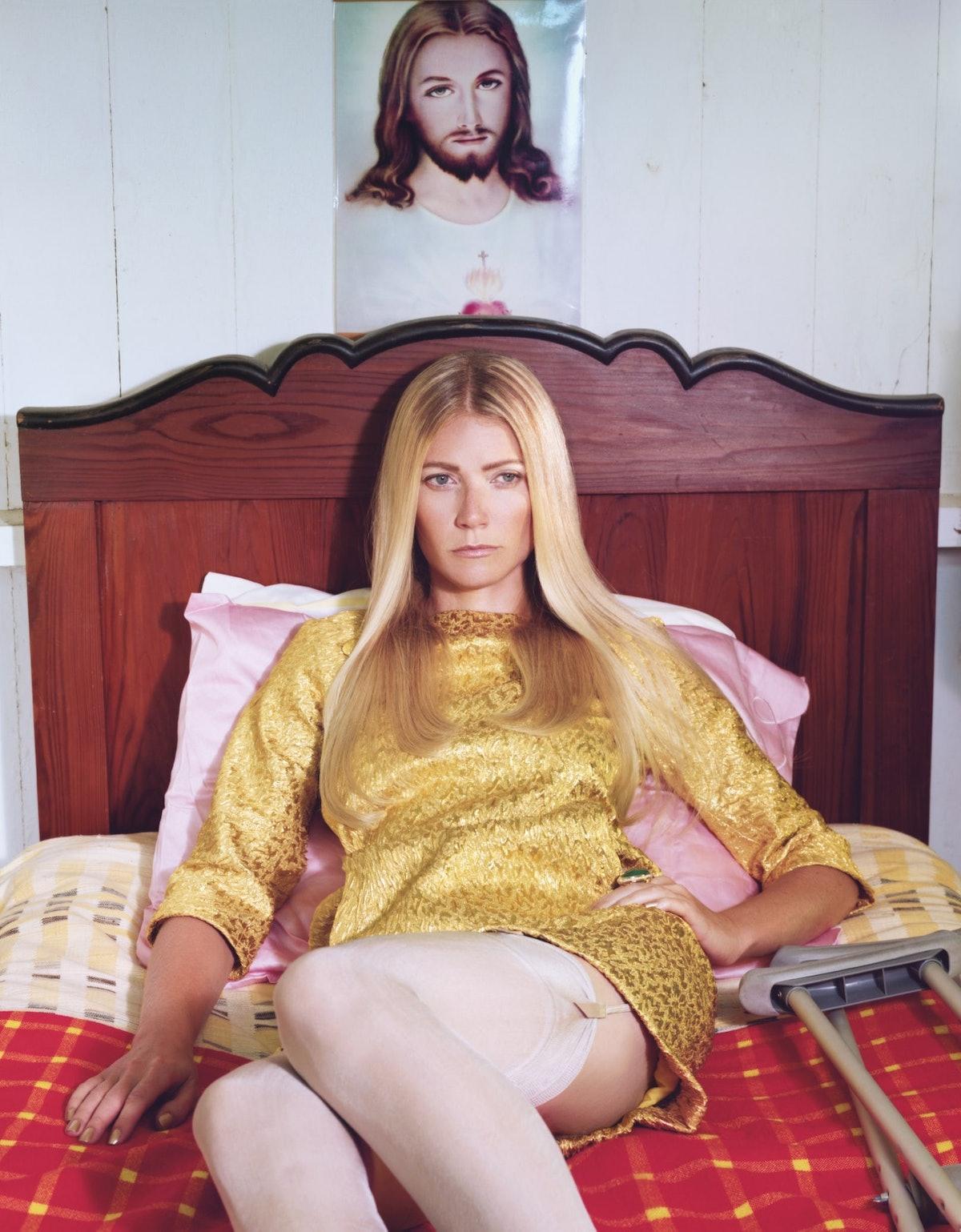 Gwyneth Paltrow in bed under a Jesus portrait