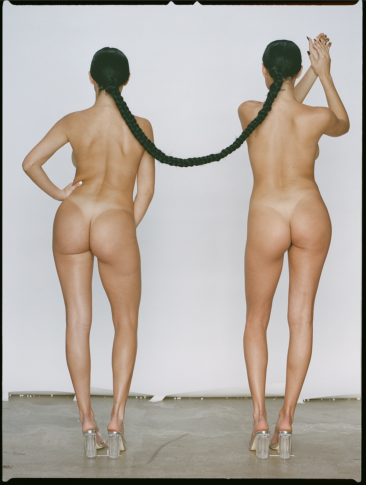 Two women with a shared braid