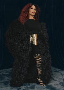 Chaka Khan wears a Lever Couture cape from Albright Fashion Library LA; Naked Wardrobe romper; Graha...