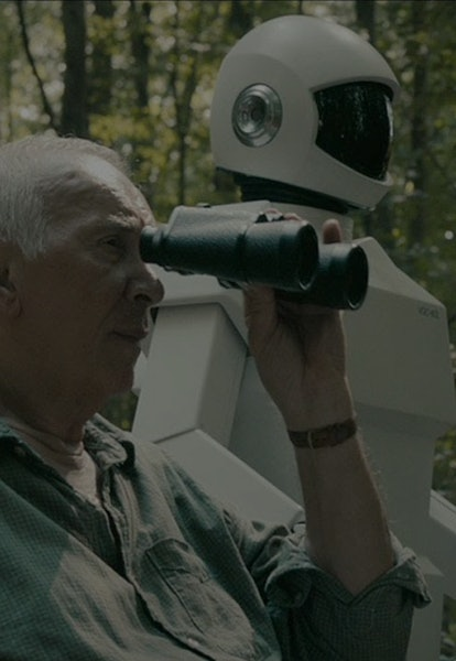 frank langella holding binoculars in robot and frank