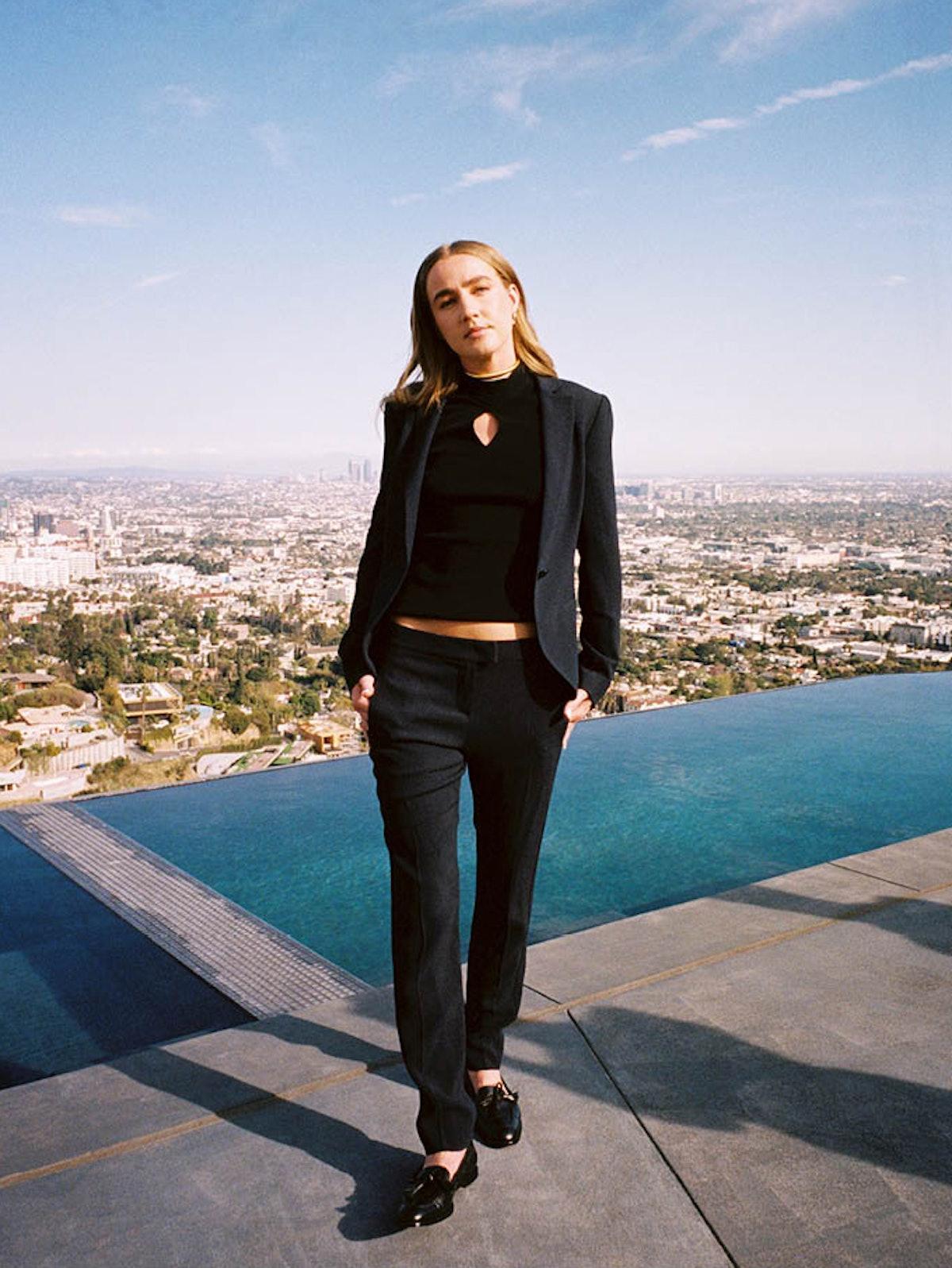 Ingrid Andress wears a Giorgio Armani jacket, top, and pants; Sapir Bachar earrings and rings; Sophi...